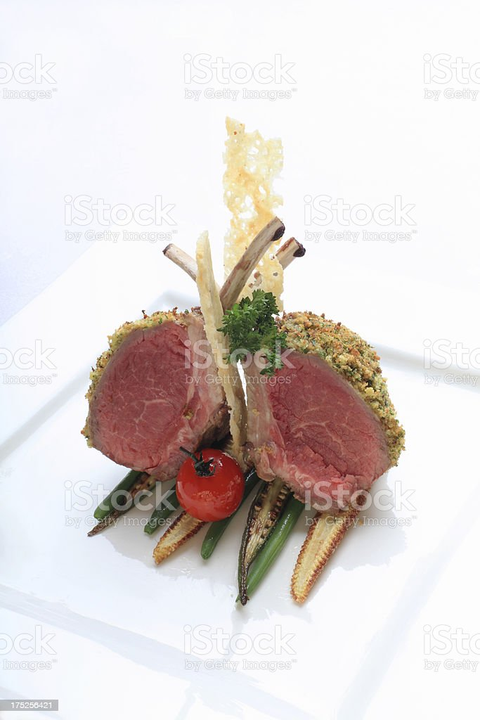 delicate lamb shop on a white plate stock photo