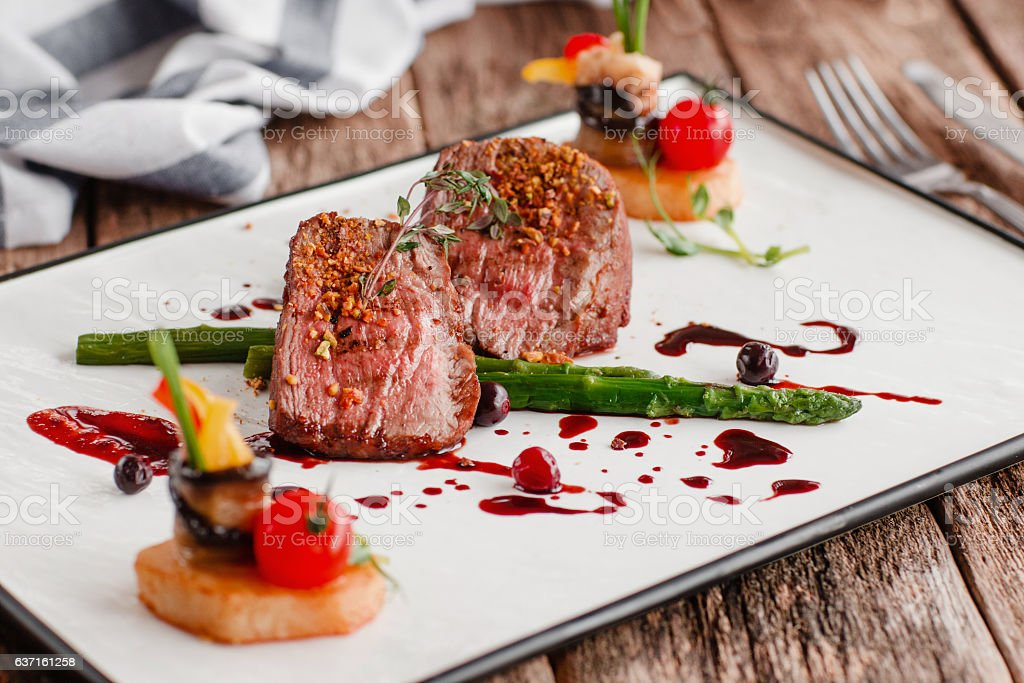 Delicate medallions of veal with vegetables stock photo