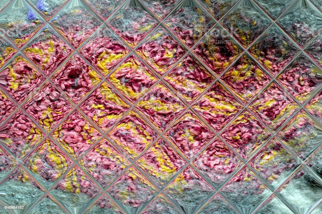 delicate pattern of glass tiles and felted wool stock photo