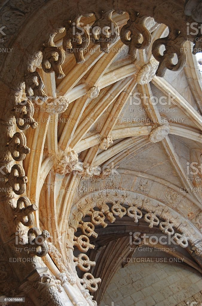 Delicately scalloped arches of Mosteiro des Jeronimos in Lisbon. stock photo