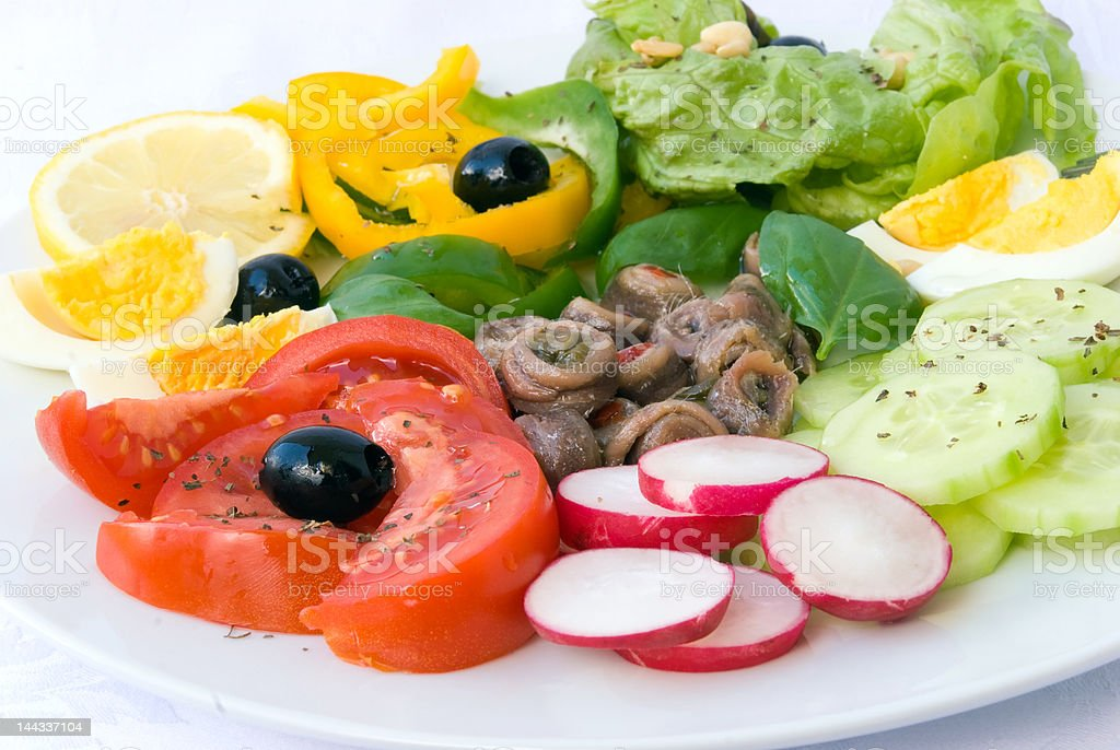 delicatessen anchovy mixed - vegetable salad with boilrd eggs royalty-free stock photo