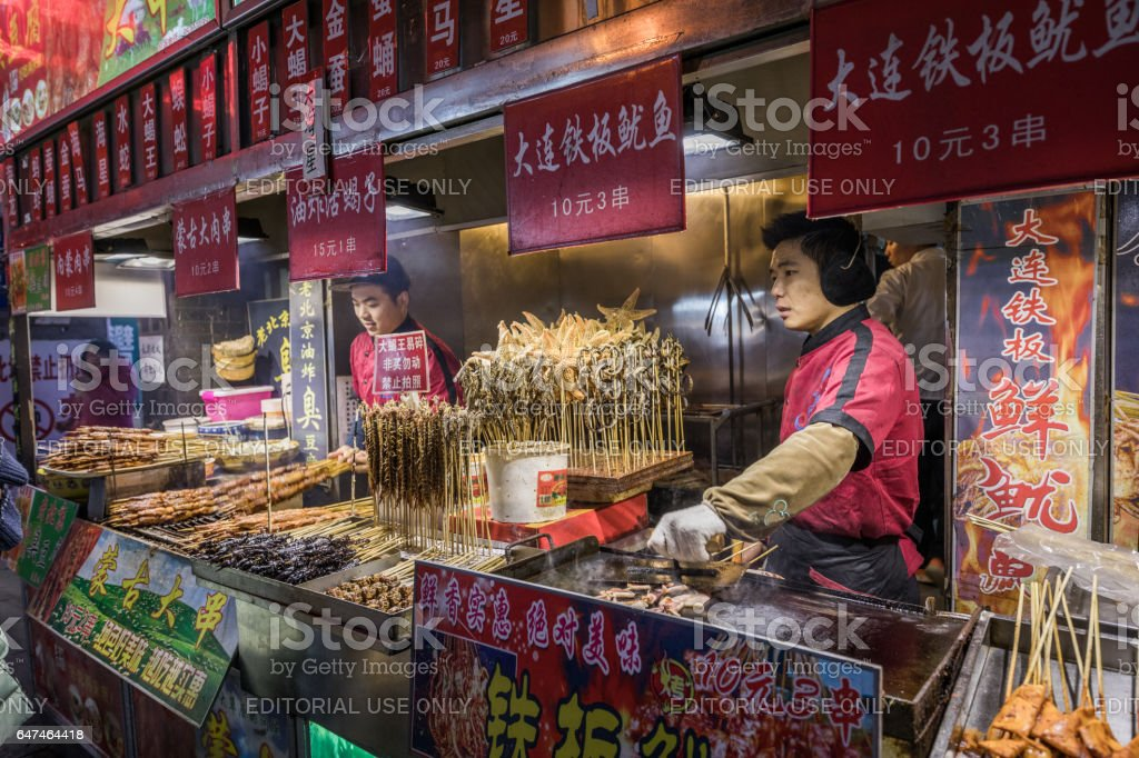 Delicatessen for sale on a bitterly cold night in Beijing stock photo