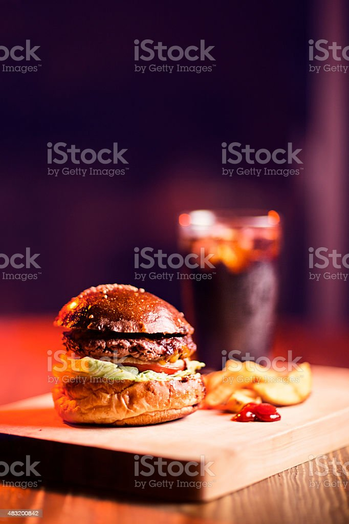 Delicious 4th of July Cheeseburger with Fries, Ketchup and Coke stock photo