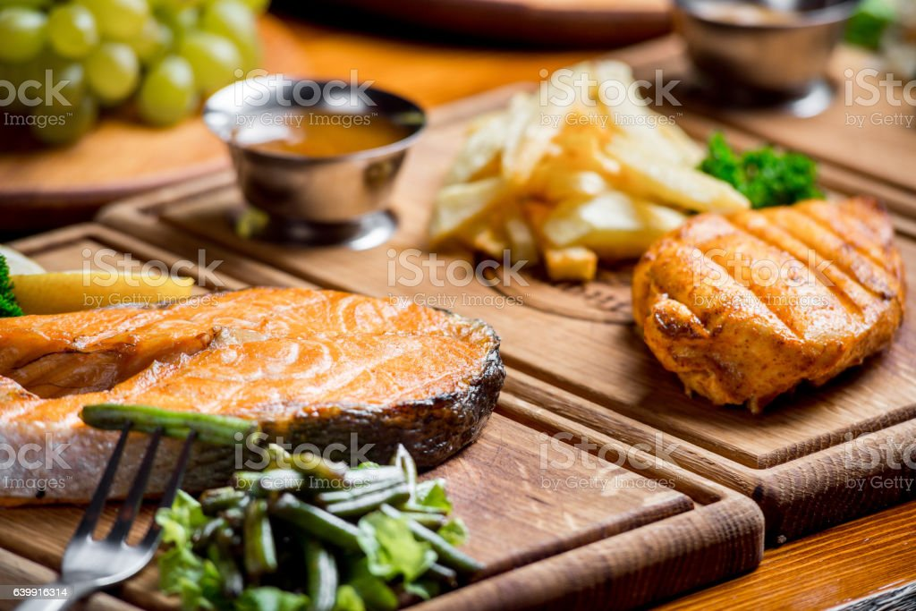 delicious and beautiful food on a wooden board stock photo