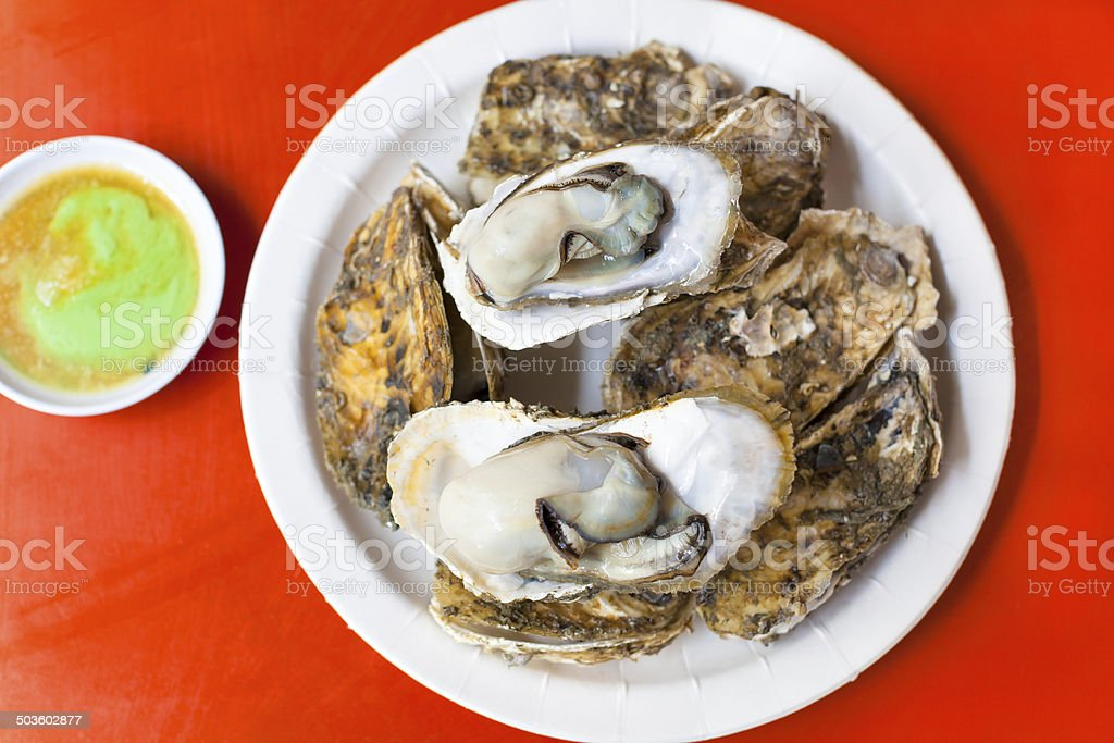 delicious and nutrition sea food  ,barbecue Oysters with mustard stock photo
