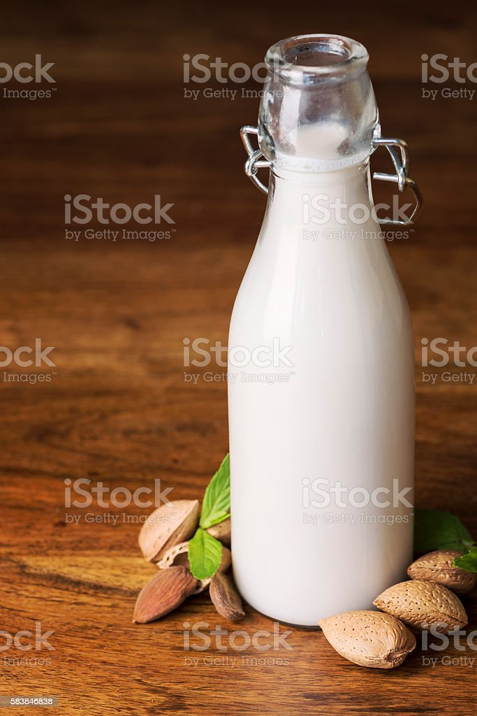 Delicious and Organic Almond Milk on wooden table stock photo