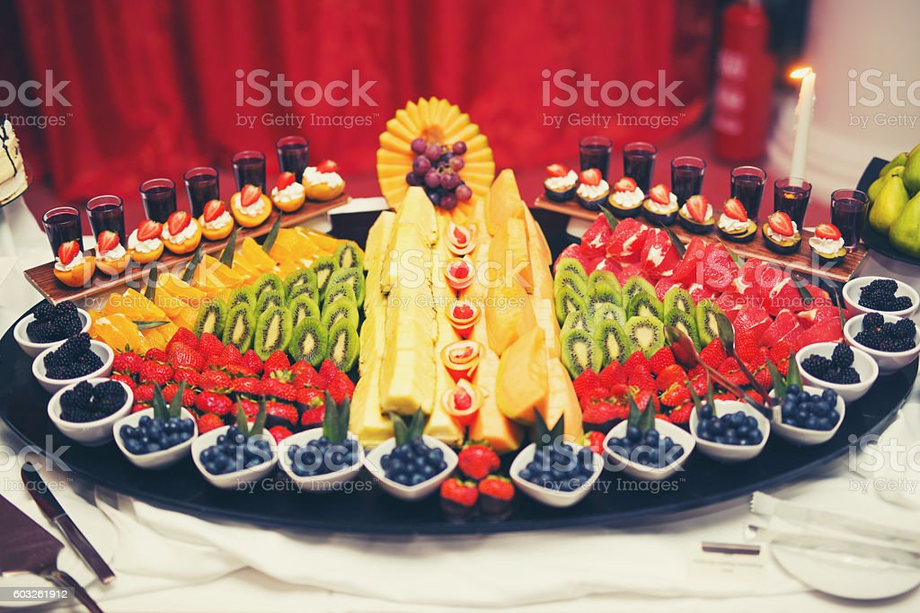 Delicious and tasty dessert table at wedding reception stock photo