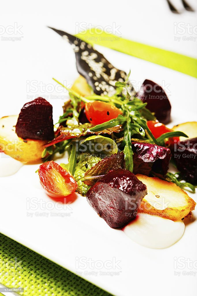 Delicious and unusual roast beetroot salad appetizer royalty-free stock photo