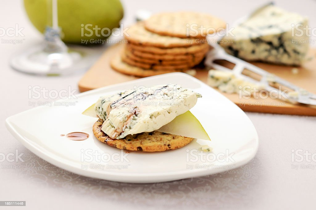 Delicious appetizer, blue cheese & pear, multi-grain cracker royalty-free stock photo