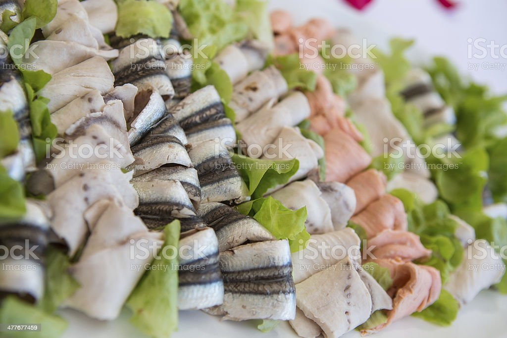 Delicious appetizer canapes on board for celebratory table royalty-free stock photo