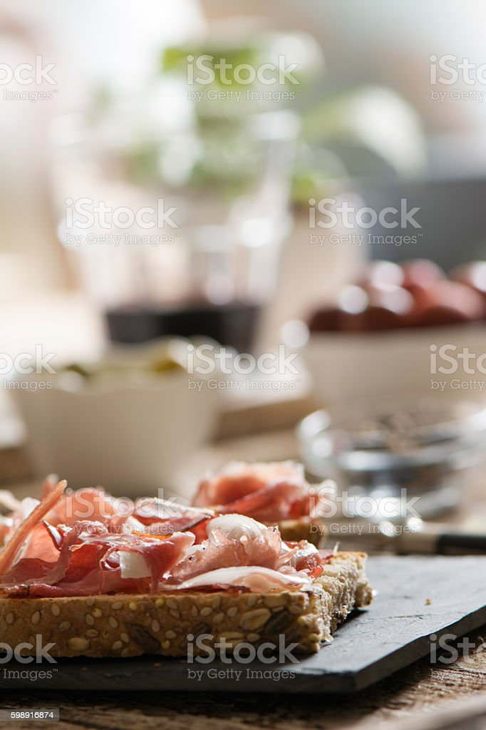 Delicious appetizer of ham and salad stock photo