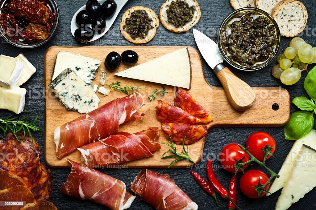 Delicious appetizer on dark slate table stock photo