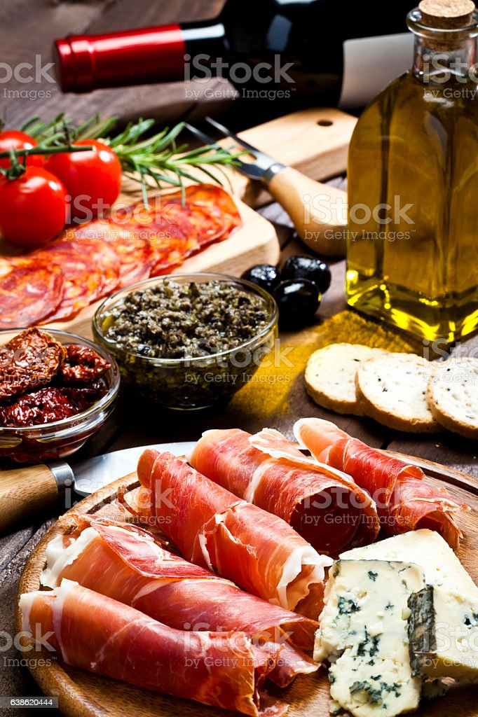 Delicious appetizer on rustic wood table stock photo