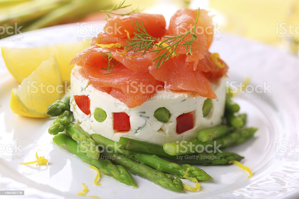 delicious appetizer with salmon, asparagus and  cream cheese. stock photo