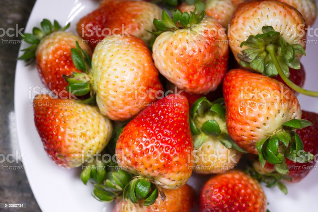 Delicious appetizing strawberry on white plate stock photo