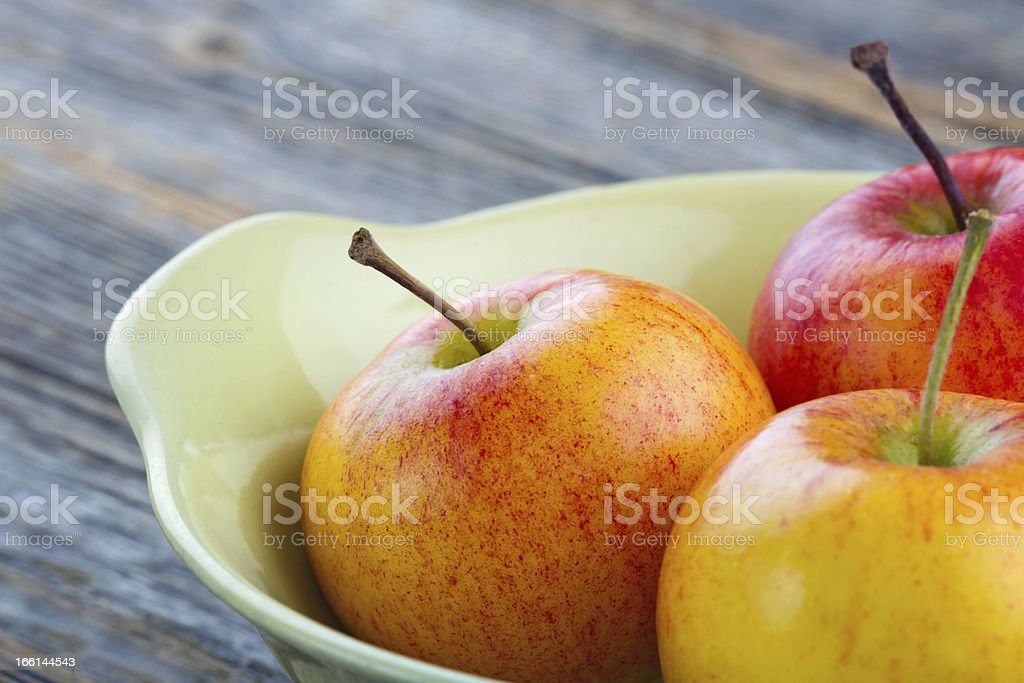 Delicious apples in a yellow bowl royalty-free stock photo
