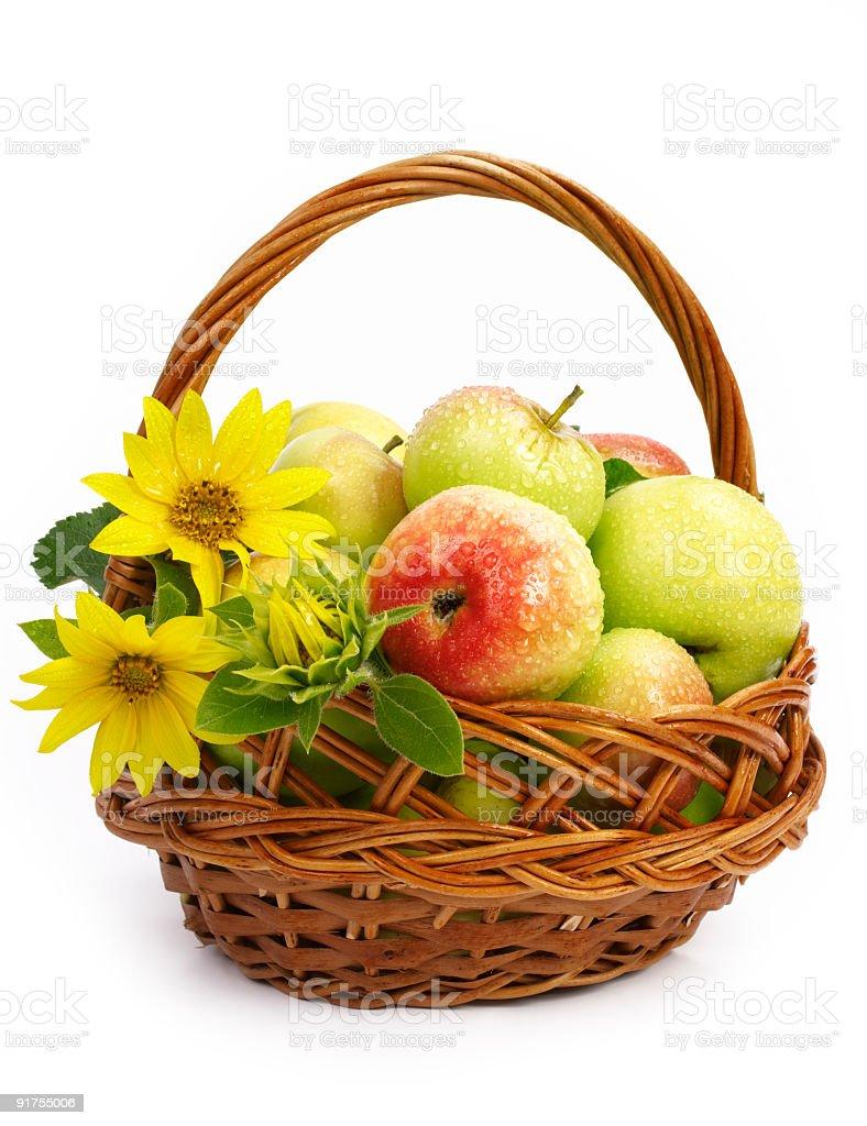 Delicious apples in wicker basket stock photo