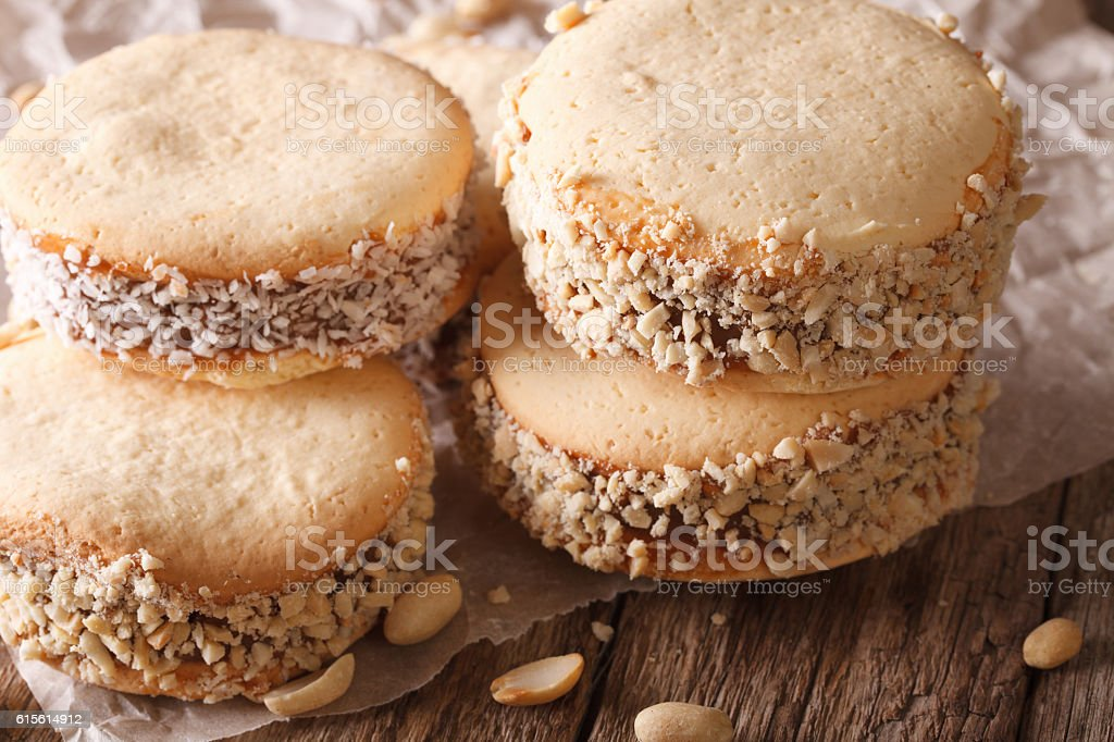 Delicious Argentinian Alfajores cookies on paper close-up stock photo