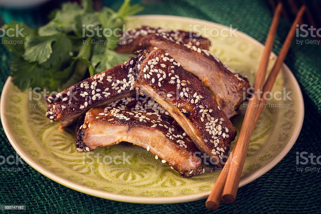 Delicious Asian BBQ Ribs with Sesame stock photo
