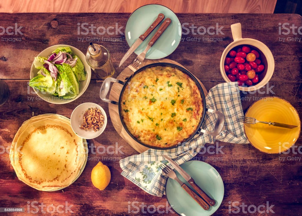 Delicious Baked Crepes Pancakes with Ham and Tomatoes stock photo