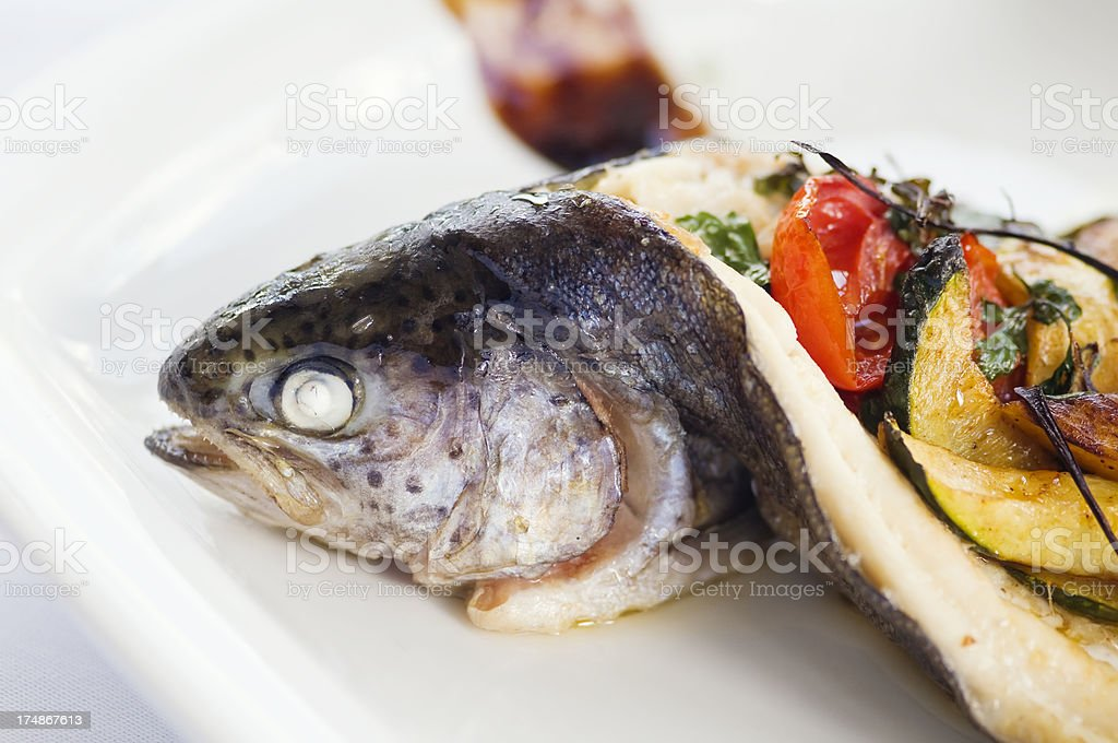 Delicious baked trout on a plate. royalty-free stock photo
