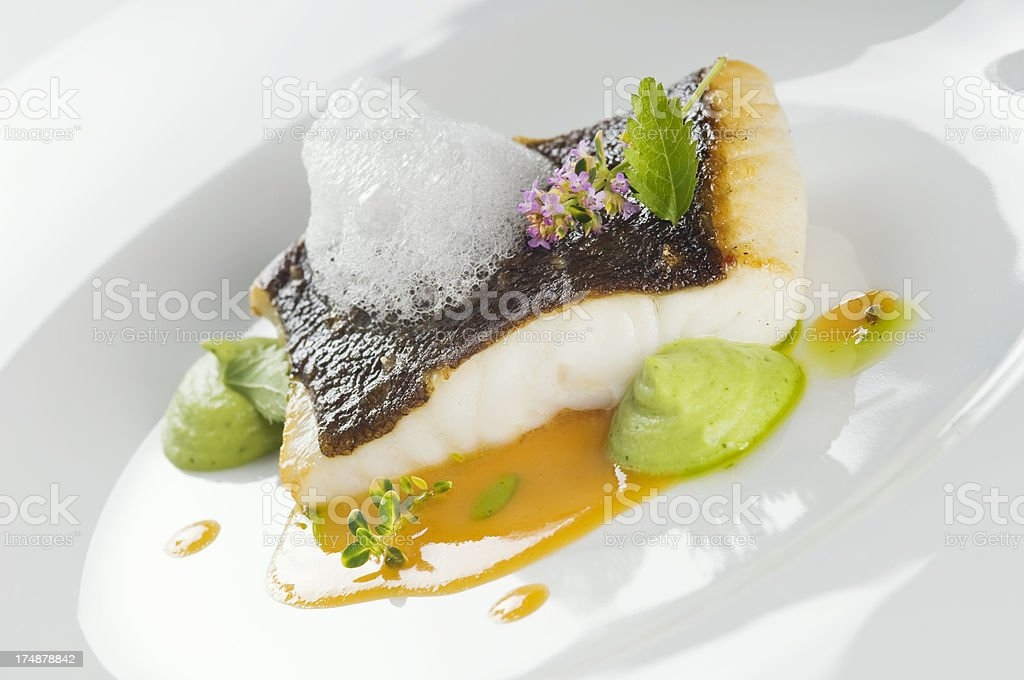 Delicious baked turbot fillet on a plate. royalty-free stock photo