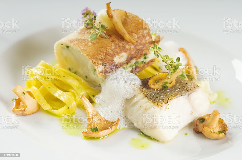 Delicious baked zander fillet on a plate. royalty-free stock photo