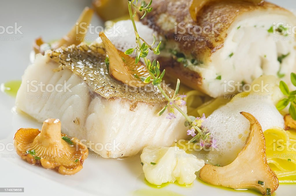 Delicious baked zander fillet on a plate. stock photo