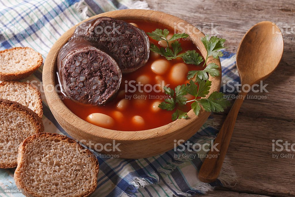 Delicious bean soup Fabada asturiana closeup horizontal stock photo