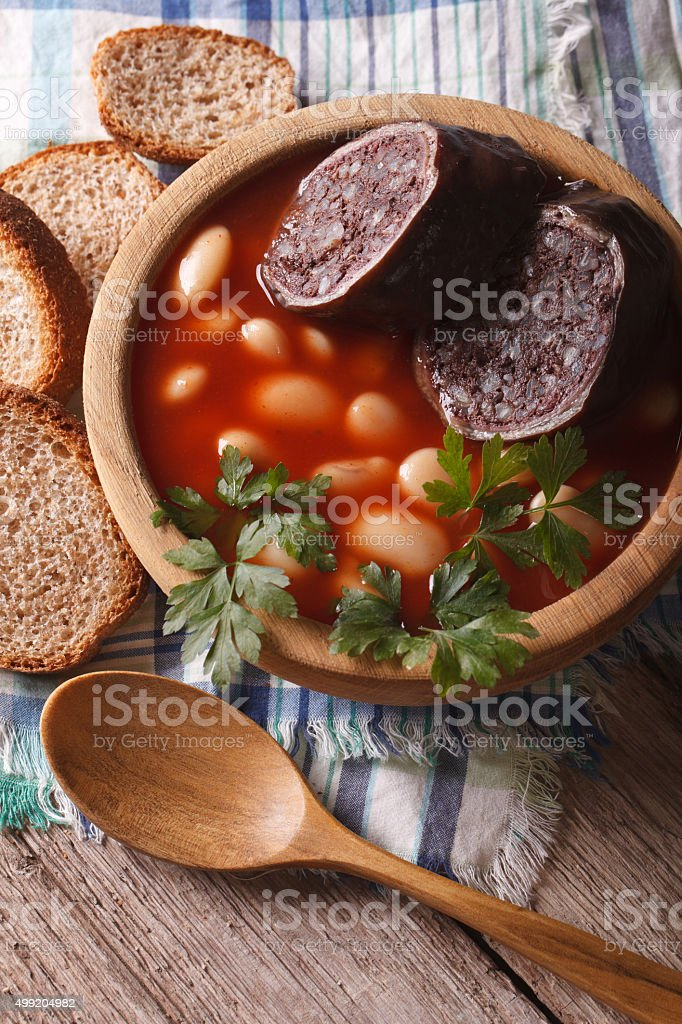 Delicious bean soup Fabada asturiana closeup vertical top view stock photo
