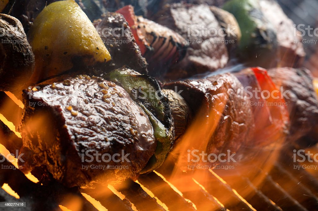 Delicious Beef Shish Kebab on a Grill with Flames` stock photo