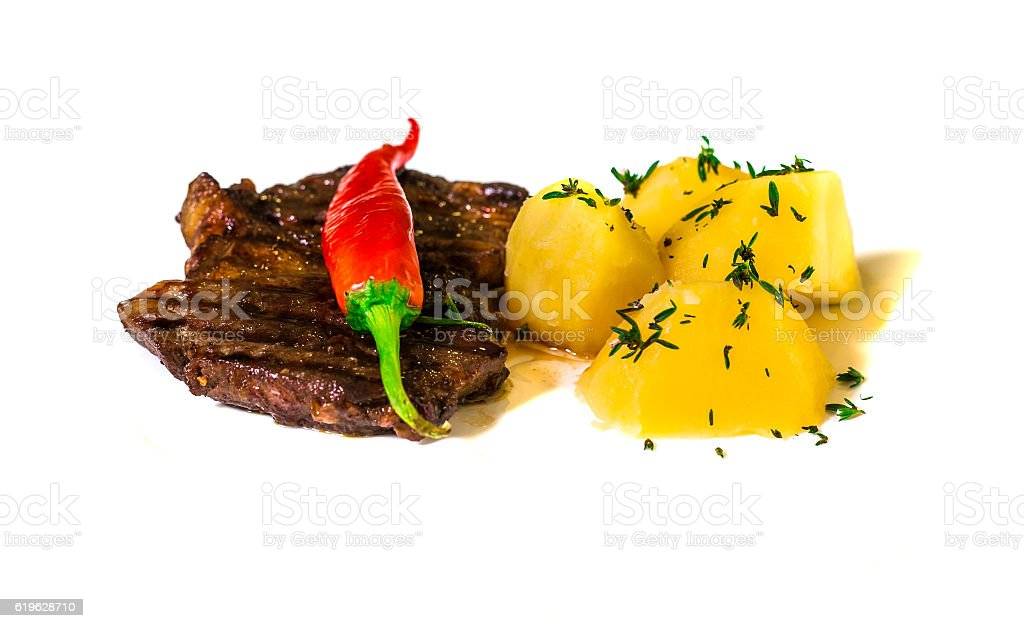 Delicious beef steak isolated on white background stock photo