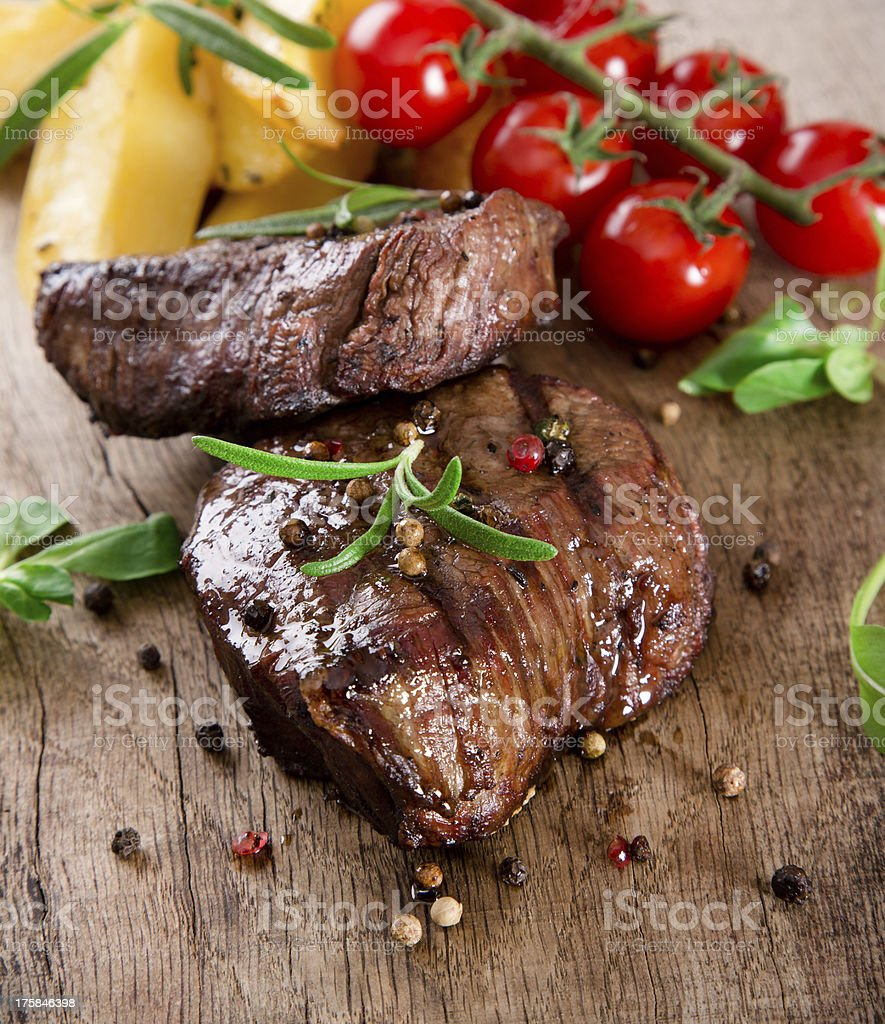 Delicious beef steak on a wooden surface royalty-free stock photo
