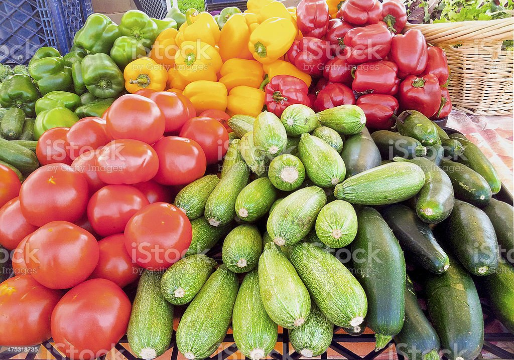 Delicious bell peppers,tomatoes,zucchinis, eggplants at farmers market. stock photo