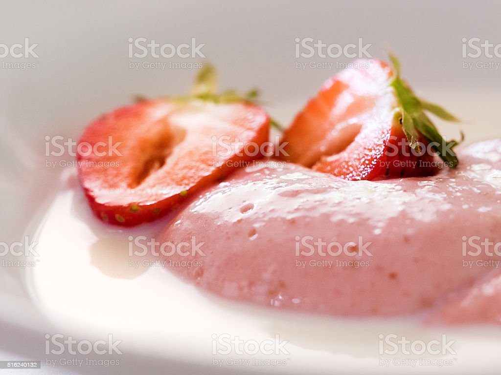 Delicious berry mousse with milk and strawberry royalty-free stock photo
