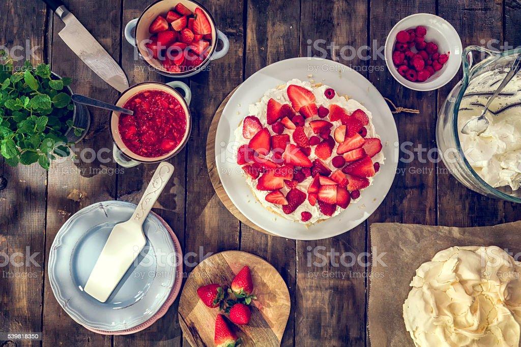 Delicious Berry Pavlova Cake with Strawberries and Raspberries stock photo