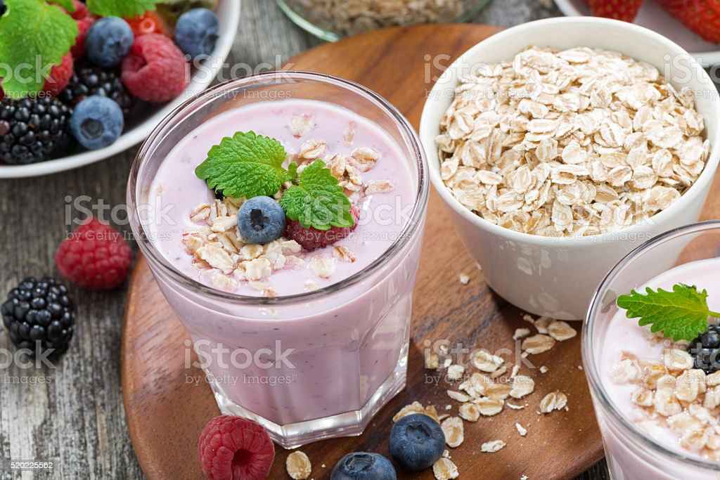 delicious berry smoothies with oatmeal in a glass stock photo