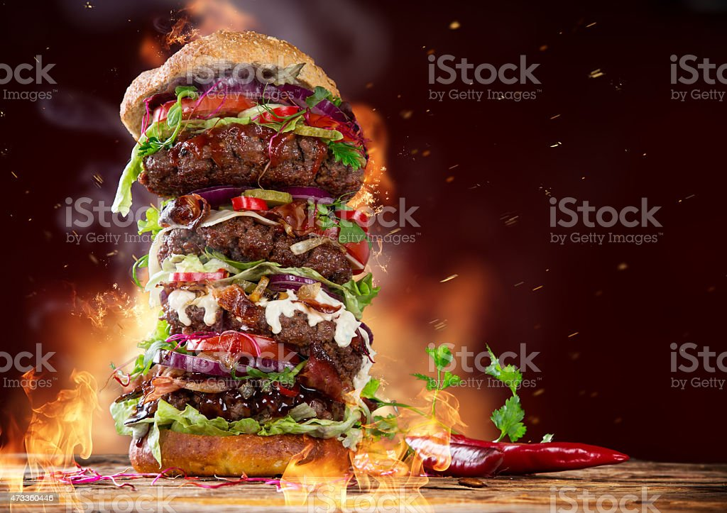 delicious big hamburger on wood stock photo