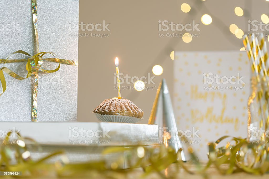 Delicious birthday cupcake with single candle on top stock photo