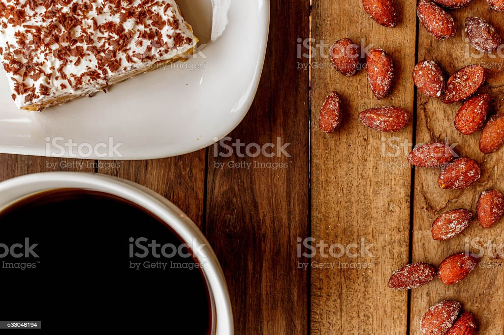 Delicious breakfast an invigorating cup of black coffee, cheesecake stock photo