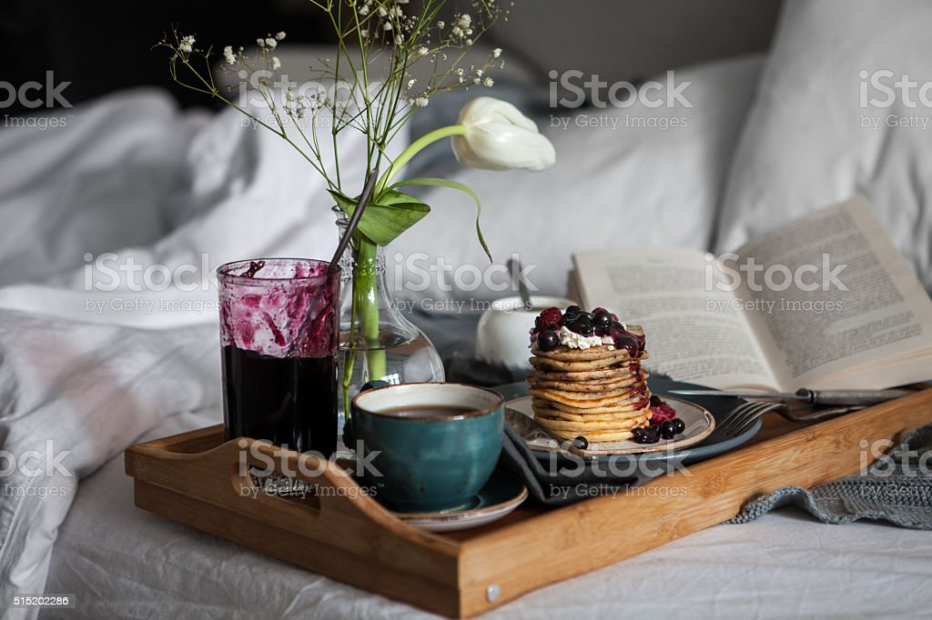 Delicious breakfast in bed stock photo