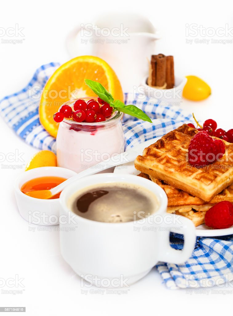 Delicious breakfast with fresh coffee, waffles and fruits stock photo