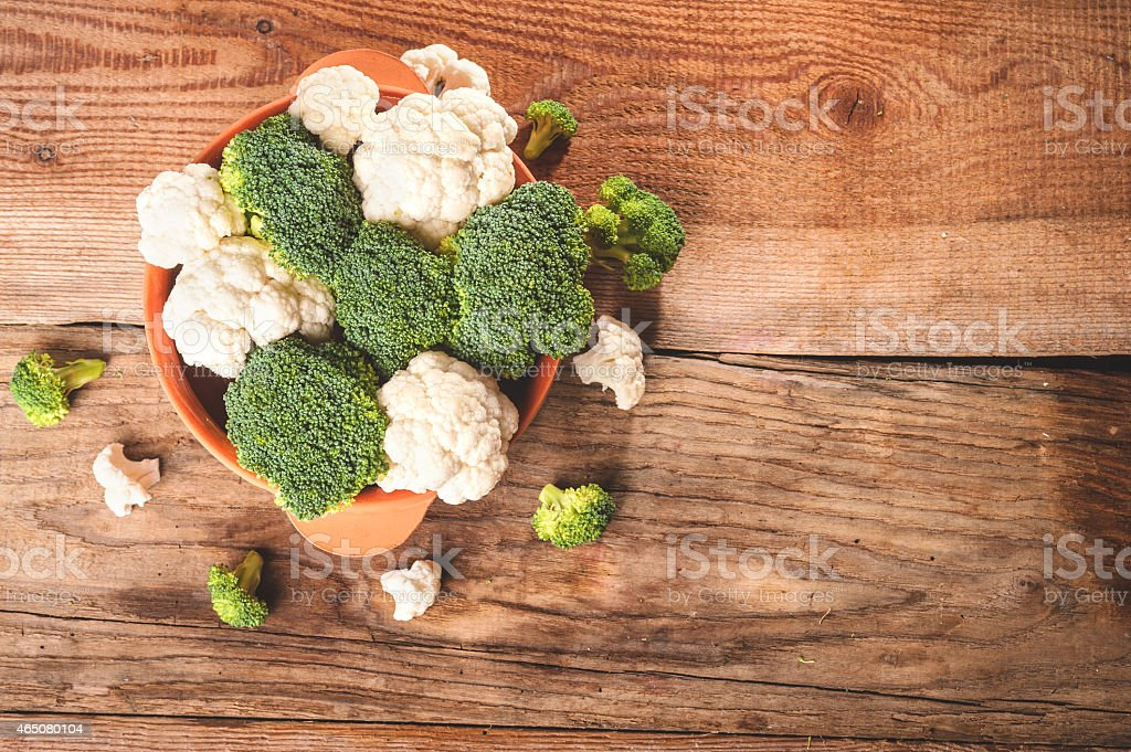 Delicious broccoli and cauliflower has a wooden rustic table stock photo