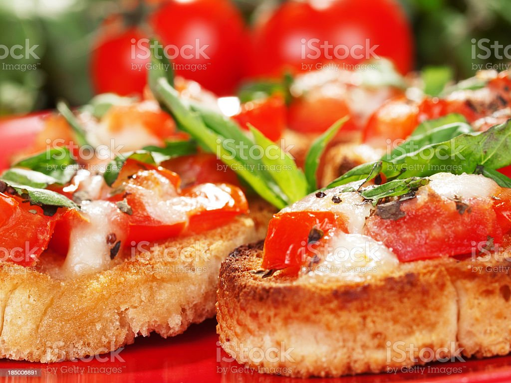 A delicious bruschetta topped with tomatoes stock photo