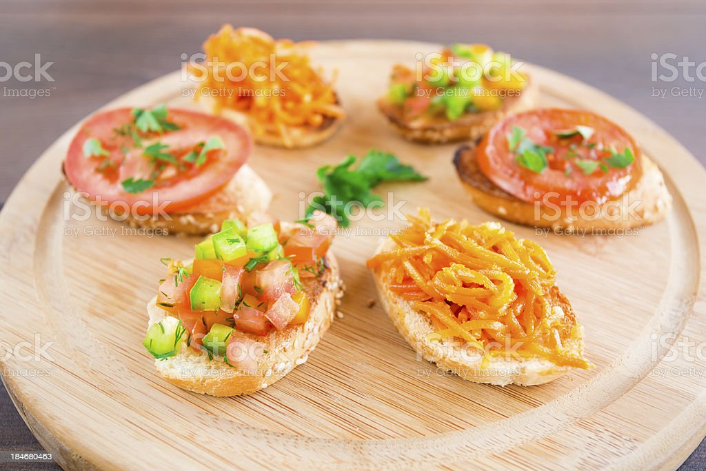 Delicious bruschetta with vegetables and herbs royalty-free stock photo