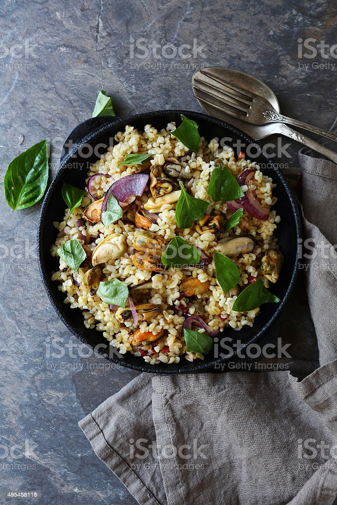 delicious bulgur and seafood stock photo