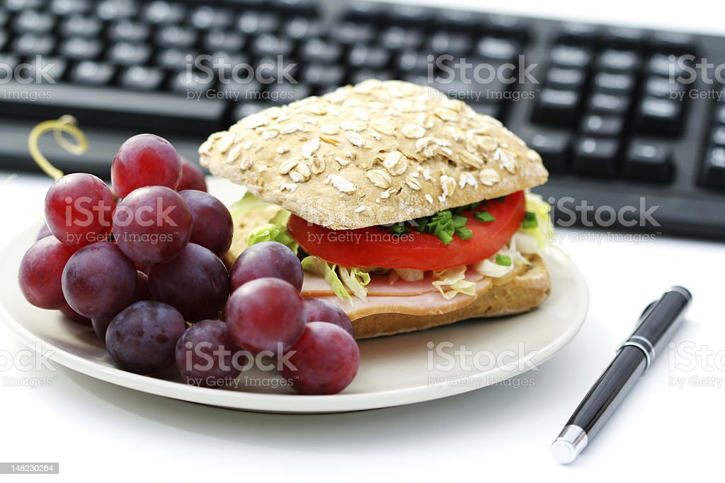 Delicious bun and fresh grapes for breakfast stock photo