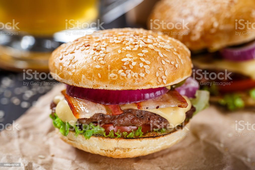 Delicious burger on wooden board stock photo