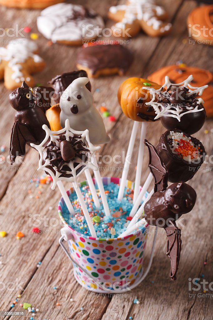 delicious cake pop Halloween in a bucket on the table stock photo