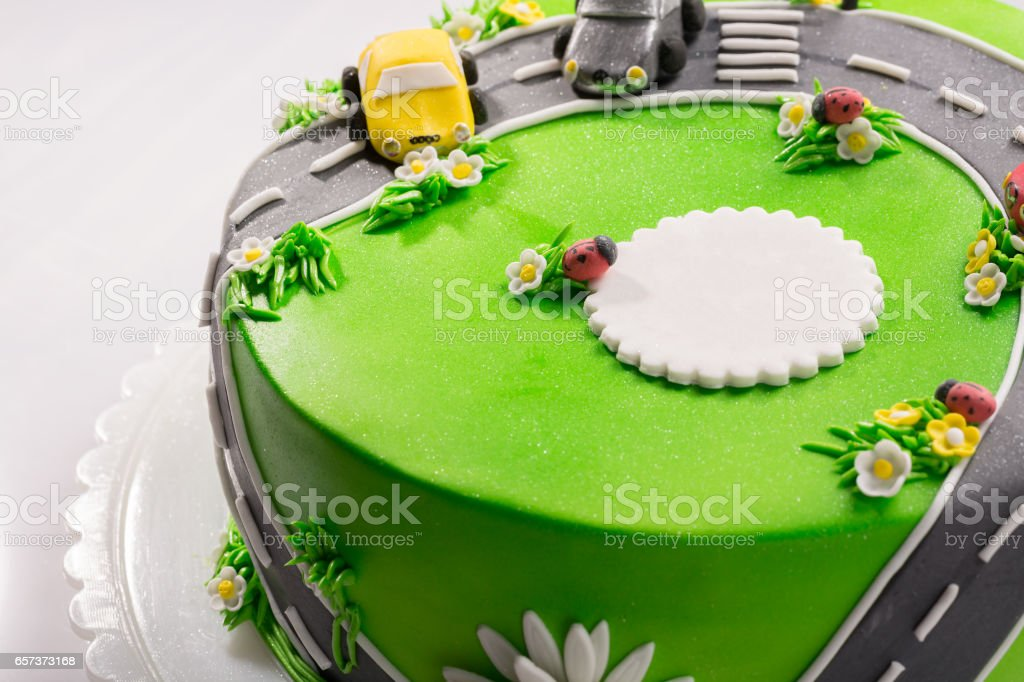 Delicious cake with ladybug and cars with free place for text close up stock photo